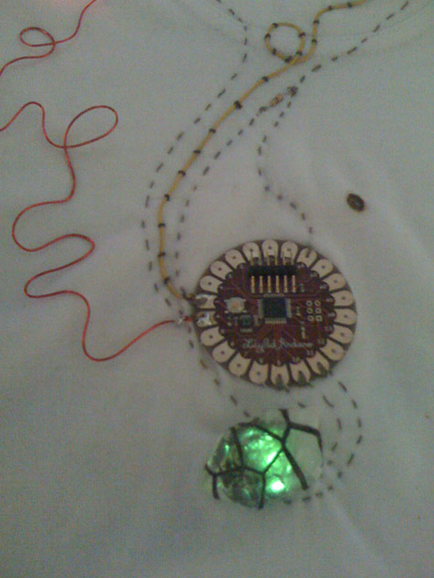 tshirt with rock crystal that glows red, green or blue according to your temperature. Controlled using the arduino lilypad. By Vicky Forrester